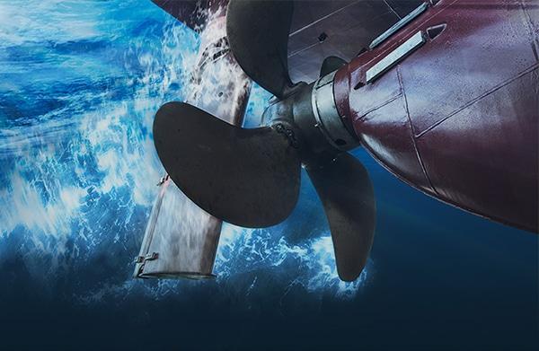 Propeller and rudder of big ship underway view from underwater.